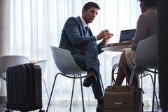 Business people waiting for flight at airport cafe Stock Photo