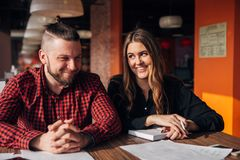 Man and woman sitting in cafe together, business lunch brake Royalty Free Stock Photography