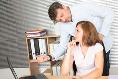 Man and woman are speaking together at the table in the office and both are Look at each. Man and women are speaking together at the table in the office and both royalty free stock photos