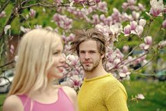 Man and woman in spring.magnolia, couple in love in spring flower blossom. Man and women in spring.magnolia, couple in love in spring flower blossom Stock Photography