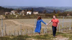 Man and woman and a typical Tuscan landscape Royalty Free Stock Photos