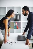 Man and woman staring at each other with hostile expressions. Man and women staring at each other with hostile expressions stock photography