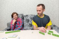 Man and woman playing mahjong Stock Photo