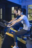 Asian man cycling exercise bikes at the gym Royalty Free Stock Images