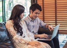 Man and woman using laptop in cafe stock photos