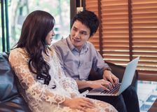 Man and woman using laptop in cafe royalty free stock photography