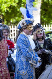 Man and women in Venetian costume talking Royalty Free Stock Photos