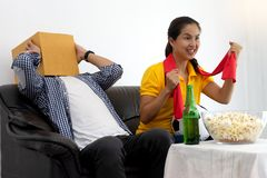 Man and woman watch Football match on tv Royalty Free Stock Photos