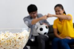 Man and woman watch Football match on tv Royalty Free Stock Photography