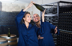 Man and women winemakers with wine bottle Stock Photography