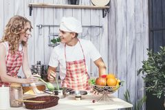 Man and woman young and beautiful couple in the kitchen home coo Royalty Free Stock Photography