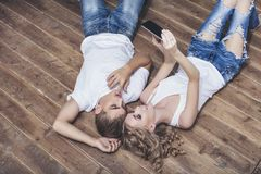 Man and woman young and beautiful couple in white shirts taking Royalty Free Stock Photo