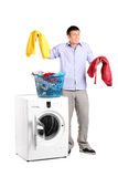 Man wondering how to do the laundry Stock Photo
