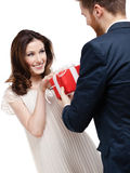Man wonders his girlfriend with International Woman's Day present. Isolated on white Royalty Free Stock Photography