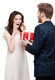 Man wonders his girlfriend with new year's present Royalty Free Stock Photography
