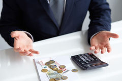 Man wonders where are his money. Man wonders why it is on the table so too little money Stock Image