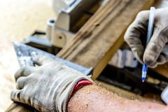 Man wood working table saw with hands and glove Royalty Free Stock Photos