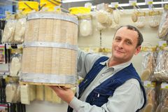 Man with wooden barrel in store Royalty Free Stock Photography