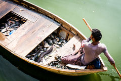Man on wooden boat fishing in jaipur Stock Photo