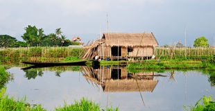 A man with wooden boat on the river in Camau, Vietnam Royalty Free Stock Photography