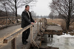 Man on wooden bridge Royalty Free Stock Photo
