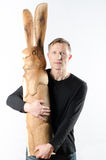 Man with wooden easter rabbit Stock Images