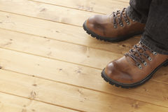 A man on wooden floor Royalty Free Stock Images