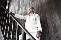 Man at wooden house Stock Photography