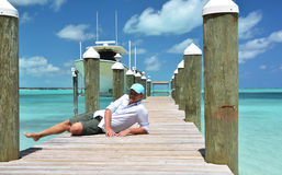 Man on the wooden jetty Royalty Free Stock Image