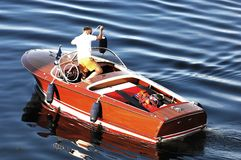 Man in wooden motorboat Stock Photography