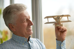 Man with wooden plane Royalty Free Stock Photos