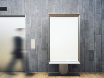 Man in wooden room with poster. Blurry view of blurry businessman walking in wooden interior with elevator and empty white poster. Mock up, 3D Rendering Stock Photography