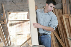 Man in wooden workshop Stock Image