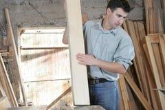 Man in wooden workshop Stock Image