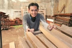 Man at woods industry Stock Images