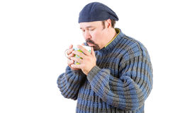 Man in a wool sweater with hot cup of tea Royalty Free Stock Photo