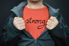 A man with the word strong on his t-shirt Royalty Free Stock Image