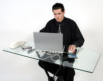Man at work. A man at work at his desk royalty free stock photography