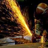Man At Work. Grinding and Sparks Flying Royalty Free Stock Image