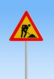 Man at work. Sign against blue sky royalty free stock image