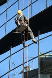 Man at work. Window washer working on a building Royalty Free Stock Images