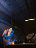 Man at work as welder in heavy industry Stock Photos