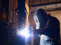 Man at work as welder in heavy industry Stock Images