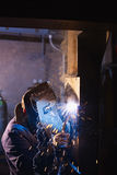 Man at work as welder in heavy industry Royalty Free Stock Image