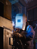 Man at work as welder in heavy industry Stock Photography