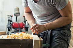Man work with a black jack plane Stock Photography