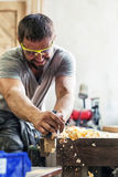 Man work with a black jack plane Royalty Free Stock Images