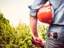 Man in work clothes with tools royalty free stock photo