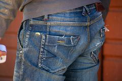 Man in work clothes. View from the back, close-up. Concept of work and employment stock images