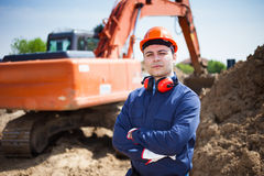 Man at work in a construction site Stock Photos